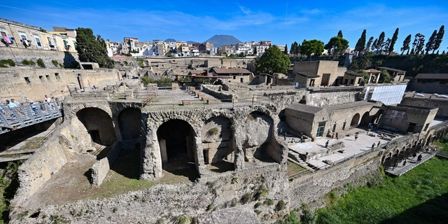 The archaeological site of Herculaneum in Ercolano, near Naples, with the Mount Vesuvius volcano in the background, on Oct. 23, 2019.