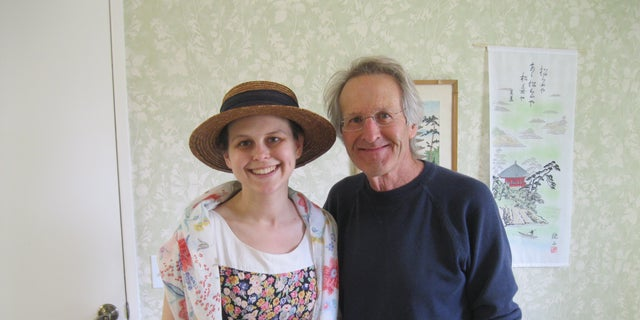 Amanda Johnson, pictured with dad Larry, started getting headaches, which was out of the norm for her.