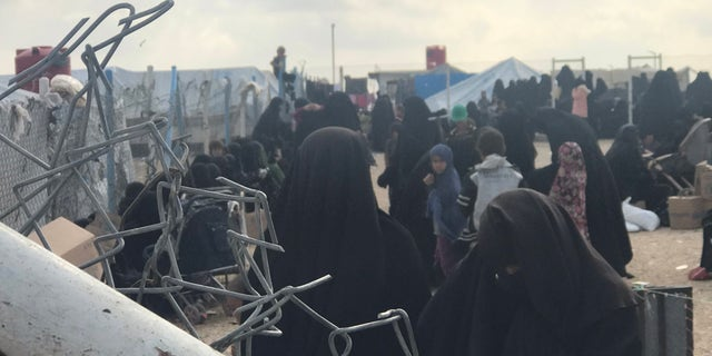 Inside the camp, the guards have no control – they are vastly outnumbered, so can secure the perimeter only. ISIS's female morality police, the al-hisba, operate across the tented city.