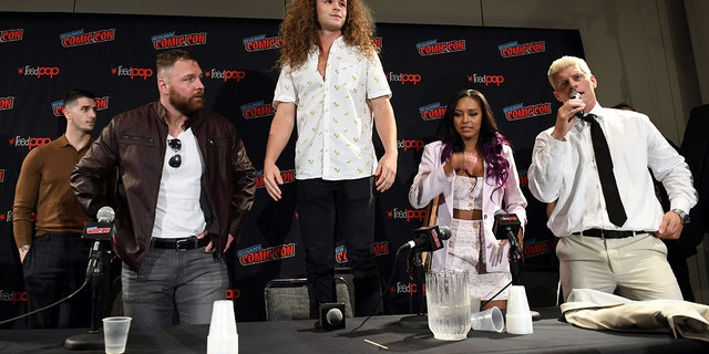 From left: Jon Moxley, Jack Perry aka Jungle Boy, Brandi Rhodes and Cody Rhodes at the Comic Con panel.