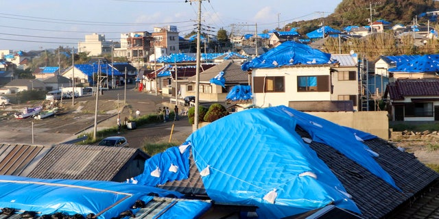 This Oct. 8, 2019, photo shows the sheet-covered roofs of the houses damaged by typhoon Faxai in Tateyama, near Tokyo.