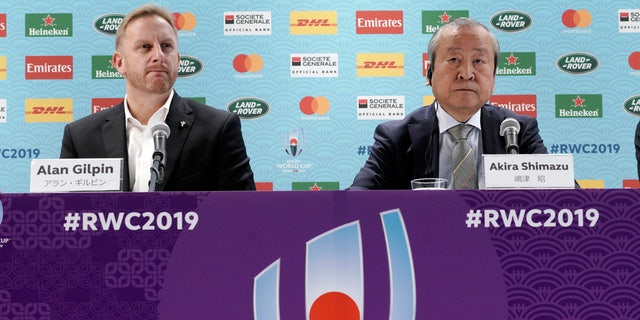 Alan Gilpin, left, tournament director for the 2019 Rugby World Cup and Japan Rugby 2019 CEO Akira Shimazu, right, attend during a press briefing on update relating to the anticipated impact of Typhoon Hagibis.