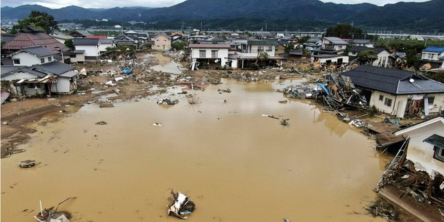 Residential area is flooded after an embankment of the Chikuma River broke due to Typhoon Hagibis, in Nagano, central Japan Tuesday, Oct. 15, 2019.