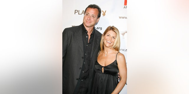 "Actor Bob Saget and Actress Lori Loughlin arrive at the ""Much Love Animal Rescue Benefit"" at the Playboy Mansion on July 14, 2007, in Los Angeles, California."
