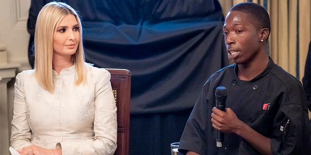 Ivanka Trump, left, listens as Johnny Brummit speaks during an event at the White House in July.