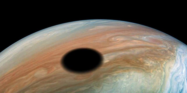 The giant black spot on the surface of Jupiter.