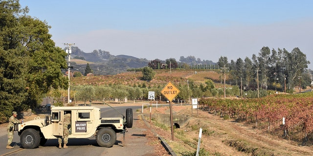 Soldiers from the 49th Military Police Brigade operate a traffic control point along Highway 101 in Healdsburg, assisting local law enforcement with evacuated areas threatened by the Kincade fire. (California National Guard)