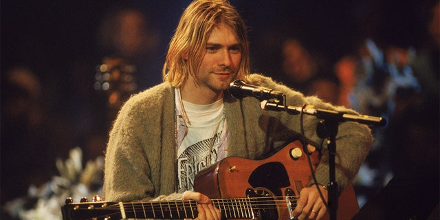 "American singer and guitarist Kurt Cobain (1967-1994) performs with his group Nirvana at a taping of the television program ""MTV Unplugged"" in New York, Nov. 18, 1993."