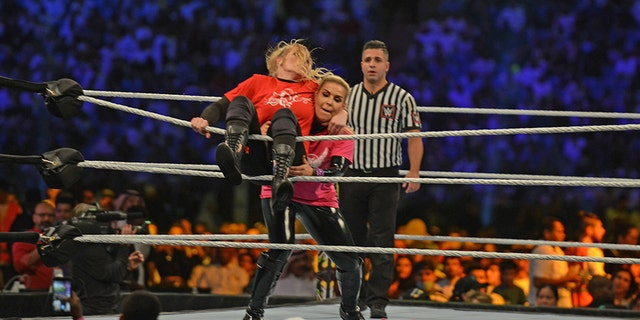 Lacey Evans (red) fights against Natalya 31, 2019 during Riyadh's World Wrestling Entertainment (WWE) Crown Jewel Pay Per View match in October. (Photo by Fayez Nureldine / AFP) (Photo by FAYEZ NURELDINE / AFP via Getty Images)