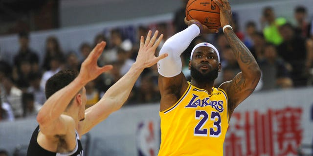 LeBron James of Los Angeles Lakers in action during a game against Brooklyn Nets at the NBA China Games 2019 in Shenzhen in southern China's Guangdong province on Saturday, October 12, 2019 (Color China Photo via AP)