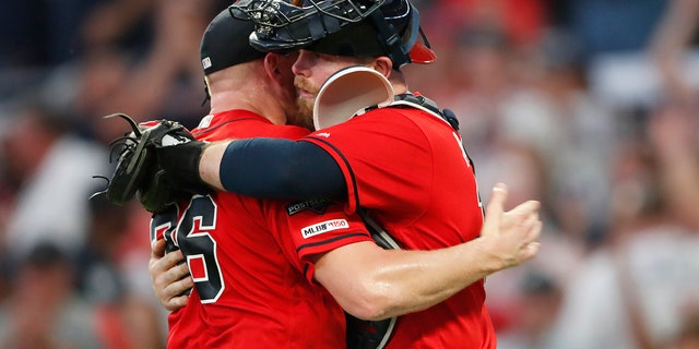 Atlanta Braves catcher Brian McCann, left, embraces Atlanta Braves catcher Brian McCann after Game 2 of a best-of-five National League Division Series St. Louis Cardinals, Friday, Oct. 4, 2019, in Atlanta. The Atlanta Braves won 3-0. (AP Photo/John Bazemore)