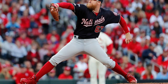 Washington Nationals relief pitcher Sean Doolittle throws during the eighth inning of Game 2 of the baseball National League Championship Series against the St. Louis Cardinals Saturday, Oct. 12, 2019, in St. Louis.