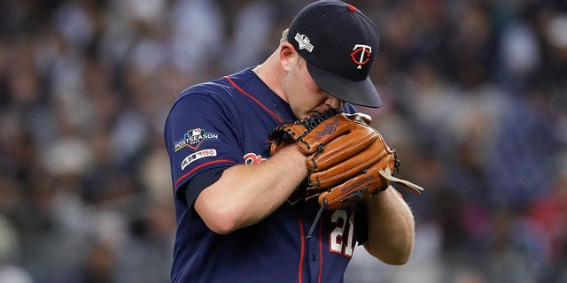Minnesota Twins relief pitcher Tyler Duffey (21) walks off the field during the third inning of Game 2 of an American League Division Series baseball game against the New York Yankees, Saturday, Oct. 5, 2019, in New York. (AP Photo/Frank Franklin II)