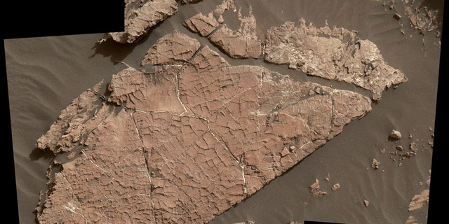 "The network of cracks in this Martian rock slab called ""Old Soaker"" may have formed from the drying of a mud layer more than 3 billion years ago. The view spans about 3 feet (90 centimeters) left-to-right and combines three images taken by the MAHLI camera on the arm of NASA's Curiosity Mars rover. (Credit: NASA/JPL-Caltech/MSSS)"