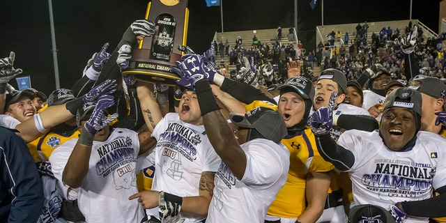 University of Mary Hardin-Baylor celebrates after the Division III Men's Football Championship held at Salem Stadium on December 16, 2016 in Salem, Virginia. Mary Hardin-Baylor defeated University of Wisconsin-Oshkosh, 10-7 for the national title. (Photo by Don Petersen/NCAA Photos via Getty Images)