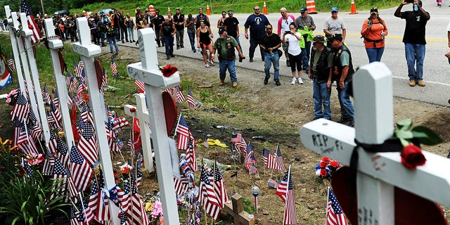 Motorcyclists visit a memorial for seven bikers killed in a June 2019 collision with a pickup truck in Randolph, N.H., July 6, 2019. (Associated Press)