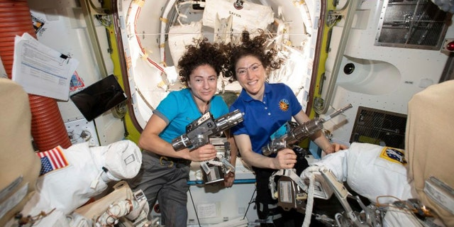 In this photo released by NASA on Thursday, Oct. 17, 2019, U.S. astronauts Jessica Meir, left, and Christina Koch, pose for a photo in the International Space Station.