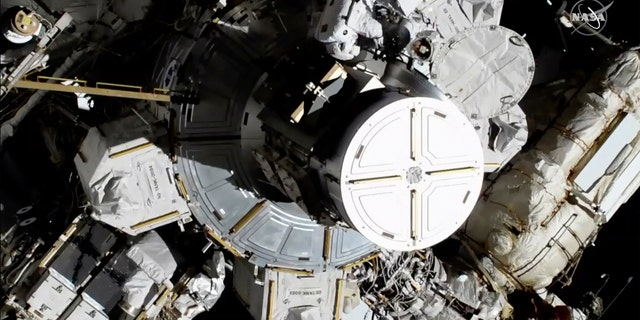 In this photo provided by NASA astronauts Christina Koch and Jessica Meir exit the International Space Station on Friday, Oct. 18, 2019. The world's first female spacewalking team is making history high above Earth.