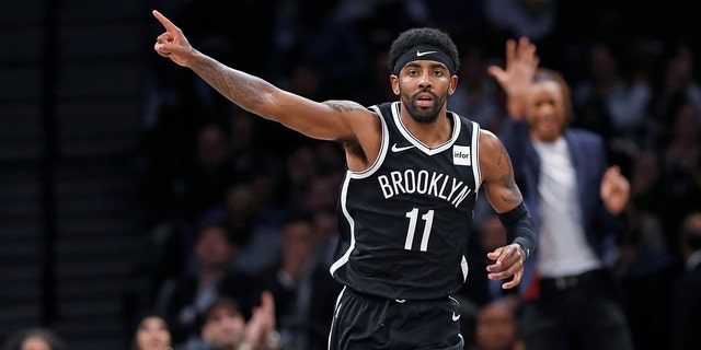 Brooklyn Nets guard Kyrie Irving (11) celebrates after scoring during the first half of the team's NBA basketball game against the Minnesota Timberwolves, Wednesday, Oct. 23, 2019, in New York. Irving had 50 points but the Nets fell to the Timberwolves in overtime, 127-126. (AP Photo/Kathy Willens)