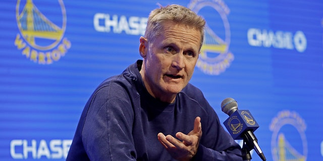 Golden State Warriors coach Steve Kerr gestures while speaking to reporters before the team's NBA basketball game against the Minnesota Timberwolves on Thursday, Oct. 10, 2019, in San Francisco. (AP Photo/Ben Margot)