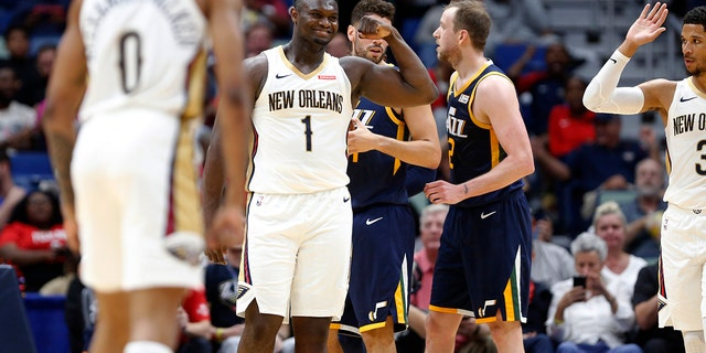 New Orleans Pelicans forward Zion Williamson (1) reacts after scoring a basket against the Utah Jazz during the second half of a preseason NBA basketball game in New Orleans, Friday, Oct. 11, 2019. The Pelicans won 128-127. (AP Photo/Tyler Kaufman)