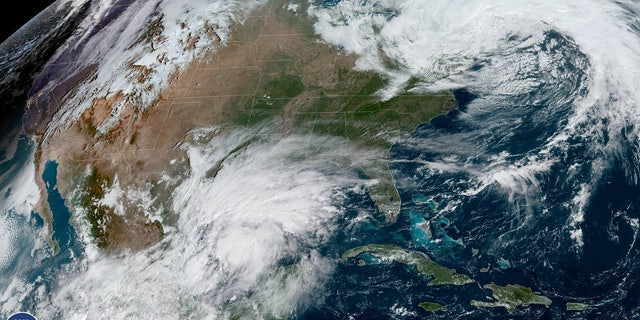 Potential Tropical Cyclone 16, which could become Tropical Storm Nestor, is seen in the southwest Gulf of Mexico on Thursday.