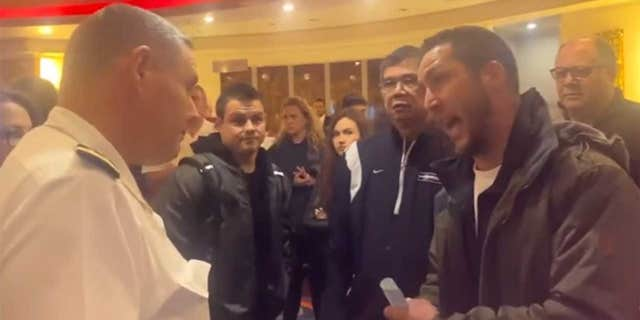 Footage taken inside the ship shows passengers demanding refunds or loudly arguing with staff members after the ship's itinerary was changed multiple times.