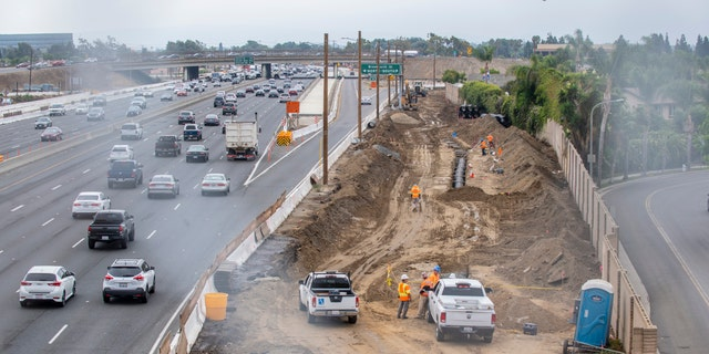 File photo of the 405 freeway widening project, Southbound traffic on the 405 freeway, at left, passes under the new Slater Avenue bridge in Fountain Valley on Wednesday, August 28, 2019.