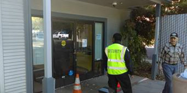 A security guard was posted outside the Pacific Gas and Electric office in Oroville, Calif. after an apparent act of vandalism on Wednesday.