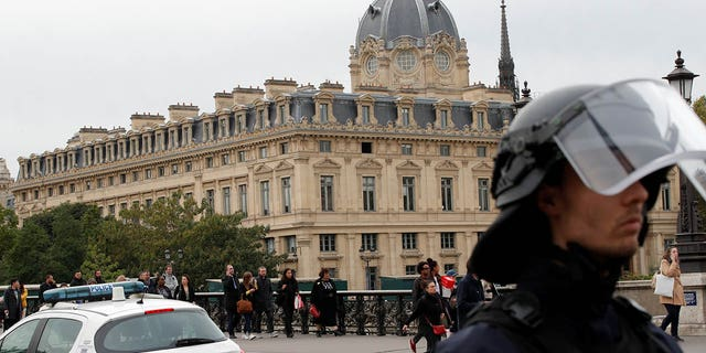 The knife attack happened around 1 p.m. inside the building, located across the street from Notre Dame Cathedral, officials said. (REUTERS/Philippe Wojazer)