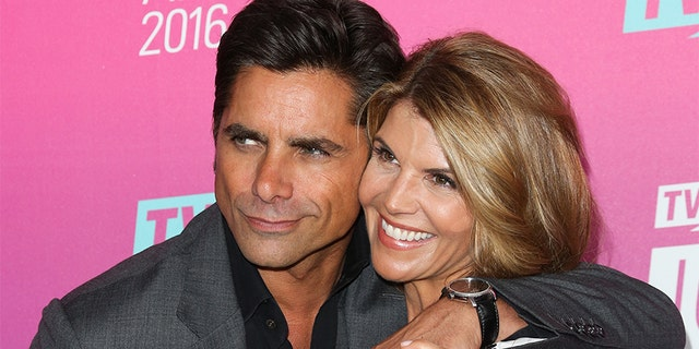 Actors John Stamos (L) and Lori Loughlin (R) attend the TV Land Icon Awards at The Barker Hanger on April 10, 2016, in Santa Monica, California.