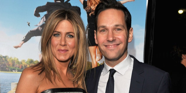 Actors Jennifer Aniston and Paul Rudd arrive during a Los Angeles premiere of Wanderlust during Mann Village Theater in California behind in 2012. (Photo by Lester Cohen/WireImage)