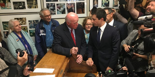Democratic presidential candidate and South Bend, Indiana Mayor Pete Buttigieg chats with longtime New Hampshire Secretary of State Bill Gardner moments before filing to place his name on the first-in-the-nation presidential primary ballot, at the State House in Concord, NH on Oct. 30, 2019
