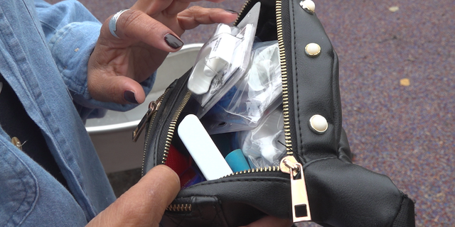 """Roz Pichardo, 41, wears a fanny pack every day. In it, she carries her cellphone, a small bible, and naloxone. Pichardo is a """"zero responder,"""" or a bystander who steps in to reverse the effects of an overdose before medical professionals get to the scene."""