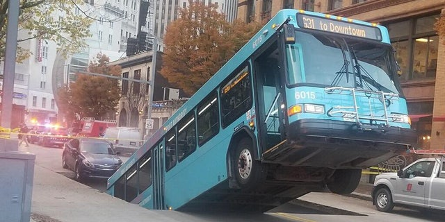 A bus was swallowed in a sinkhole in downtown Pittsburgh on Monday.