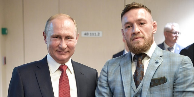 Russian President Vladimir Putin and Irish MMA fighter Conor McGregor at the final match of the 2018 FIFA World Cup in Russia.