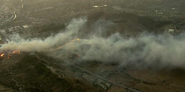 The Easy Fire broke out in Simi Valley, Calif. early Wednesday and was burning near the Ronald Reagan Presidential Library and Museum, seen to the right.