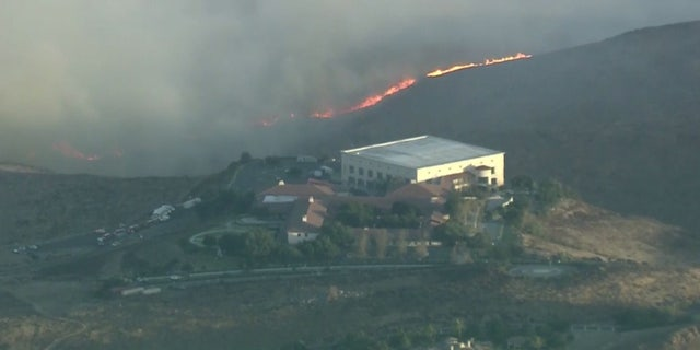 Flames could be seen on the hills near the Ronald Reagan Presidential Library in Simi Valley, Calif.