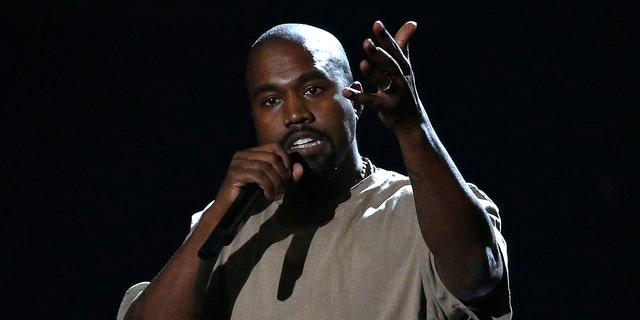 Kanye West accepts the Video Vanguard Award at the 2015 MTV Video Music Awards. REUTERS/Mario Anzuoni