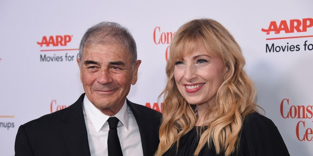 """Robert Forster, left, and Denise Grayson attend the 18th Annual Movies For Grownups Awards at Beverly Wilshire Hotel, in Beverly Hills, Calif. Forster, the handsome character actor who got a career resurgence and Oscar-nomination for playing bail bondsman Max Cherry in """"Jackie Brown,"""" has died at age 78. Forster's agent Julia Buchwald says he died Friday, Oct. 11, 2019, at home in Los Angeles of brain cancer. (Photo by Phil McCarten/Invision/AP, File)"""
