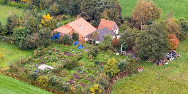 An aerial picture taken on Oct. 15, 2019 shows a view of the farm where a father and six children had been living in the cellar, In Ruinerwold, located inthe  northern Netherlands.