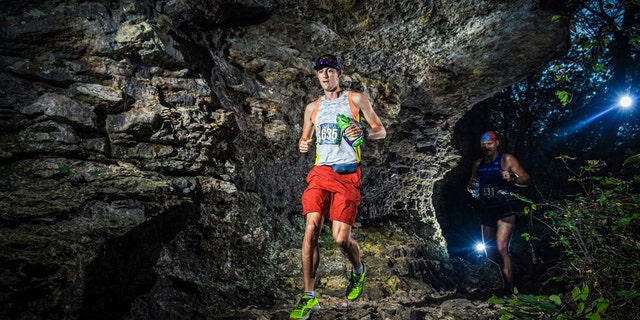In this Sept. 28, 2019 photo provided by Mile 90 Photography shows runner Thomas Stanley, left, near the start of the FlatRock 50K on Saturday, Sept. 28, 2019. Stanley was killed by lightning as he was about to finish the 50 kilometer (31.07 mile) race.
