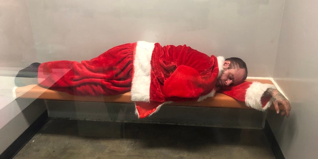 Brea Police arrested the festive man on Tuesday after they found him inside his car at around 7 a.m.