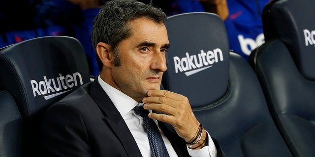 Barcelona head coach Ernesto Valverde sits prior Spanish La Liga soccer match between Barcelona and Sevilla at the Camp Nou stadium in Barcelona, Sunday, Oct. 6, 2019. Barcelona won 4-0. (AP Photo/Joan Monfort)