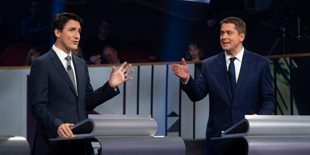 Oct. 10, 2019: Liberal leader Justin Trudeau and Conservative leader Andrew Scheer take part in the Federal leaders French language debate in Gatineau, Quebec. Polls show that Scheer has a chance to defeat Trudeau's Liberal party in national elections on Monday, Oct. 21. (Adrian Wyld/The Canadian Press via AP)