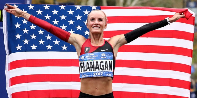 Shalane Flanagan celebrates becoming the first American woman to win the New York City Marathon since 1977 in November 2017.