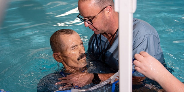 Thomas Roberts, dying of lung cancer, wheelchair-bound and unable to breathe without oxygen tubes, got his final request in life. (handout/ The University of Alabama at Birmingham)