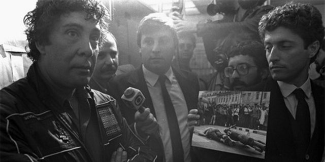 Tommaso Buscetta facing the press after his arrest in Brazil in 1983.