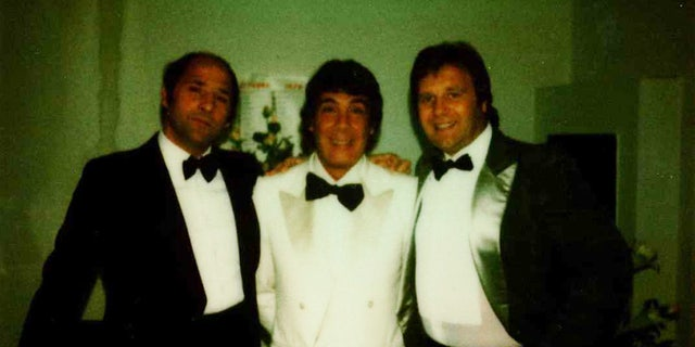 Tommaso Buscetta posing with two gangsters on his wedding day in prison.