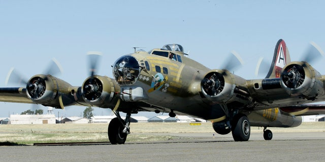 In this photo taken June 2, 2018 photo, the Nine-O-Nine, a Collings Foundation B-17 Flying Fortress taxis after landing at McClellan Airport in Sacramento, Calif.